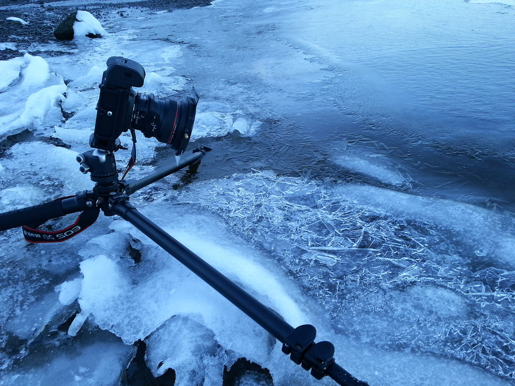 Placing one of the tripod's legs in the water - problem solved!