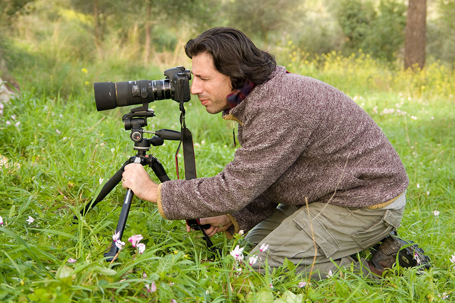 Photographer Shy Cohen doing what he does best: shooting in nature.