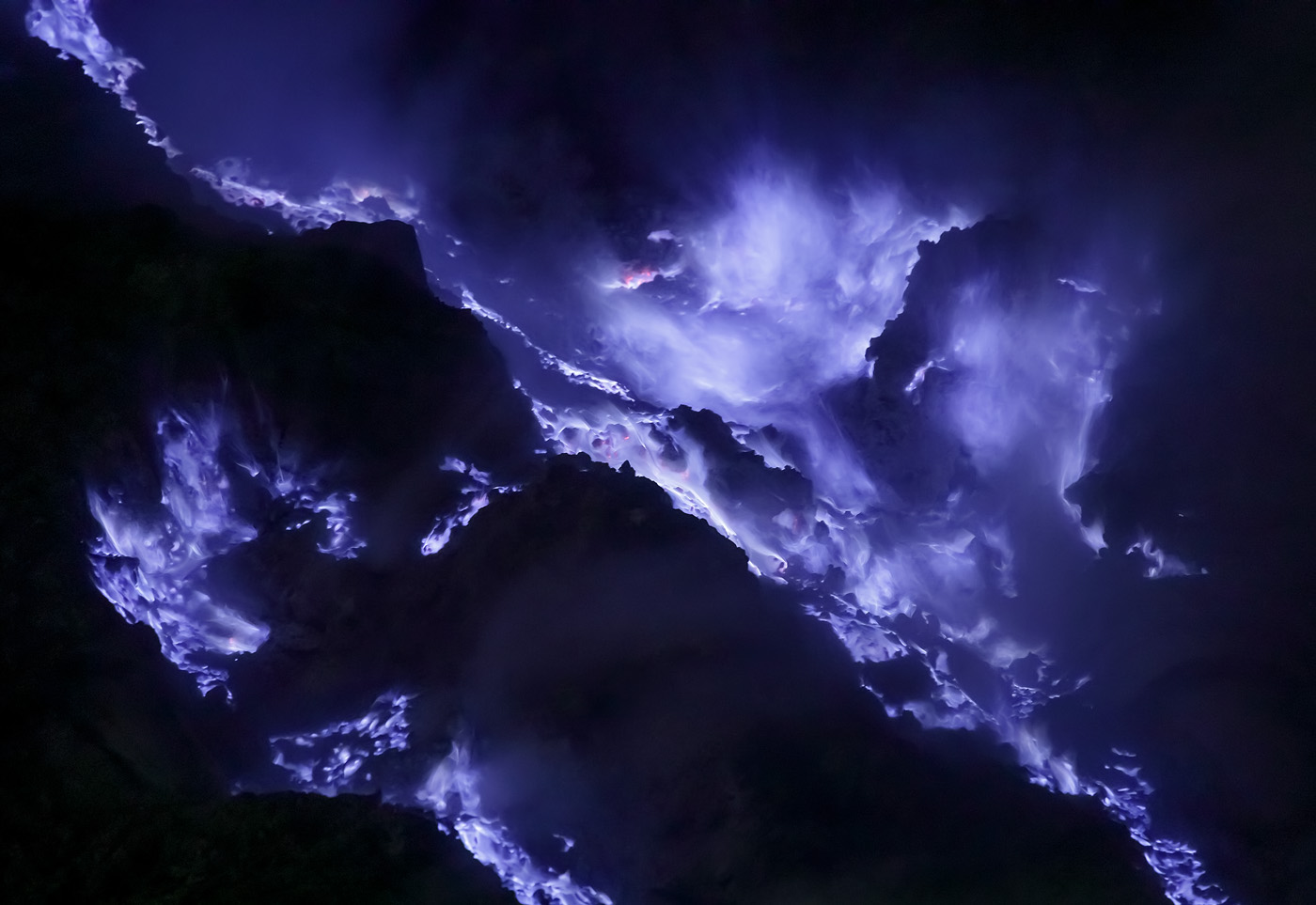 Purple fire in Kawah Ijen. Note the diagonal lines and the two main centers of compositional mass in the top right and in the bottom left, balancing each other.