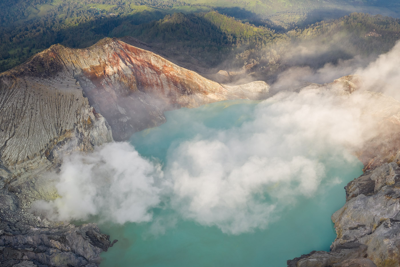 In this aerial I used layering as a compositional tool. Notice how the layers of smoke/lake/bare mountain/ lush forest, together with light and shadow, create both depth and continuity, and tell a story of natural contrasts.