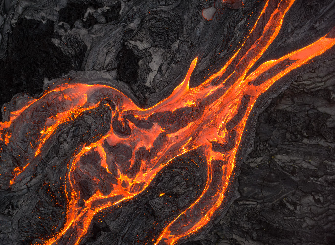 Lava surface-flows in Kilauea Volcano, Hawaii. A top-down perspective resulted in a deliberate lack of depth, which in turn allowed me to concentrate the viewer on the shape of the flows.