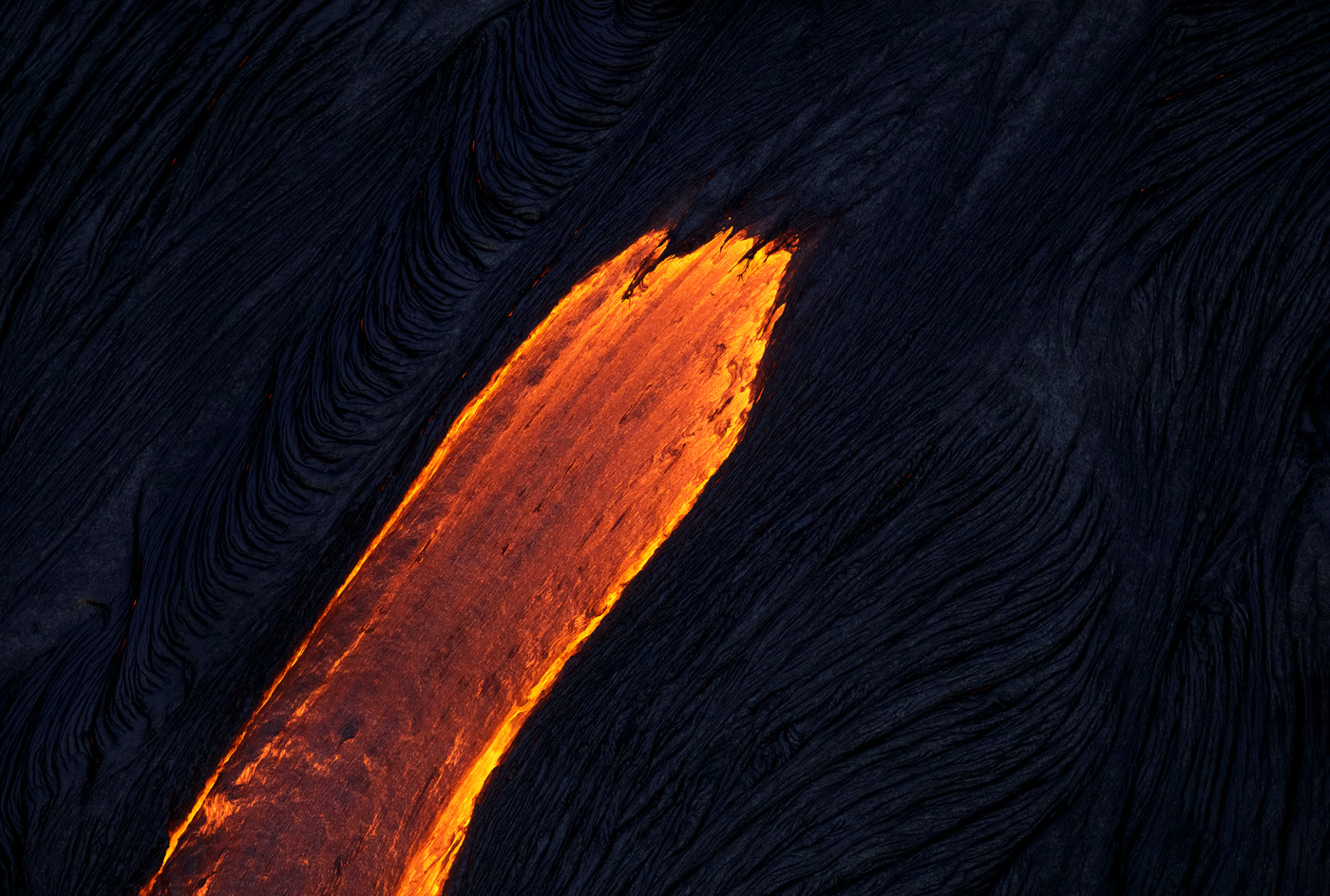 The lava surface flows look like painted brush-strokes on the dark earth