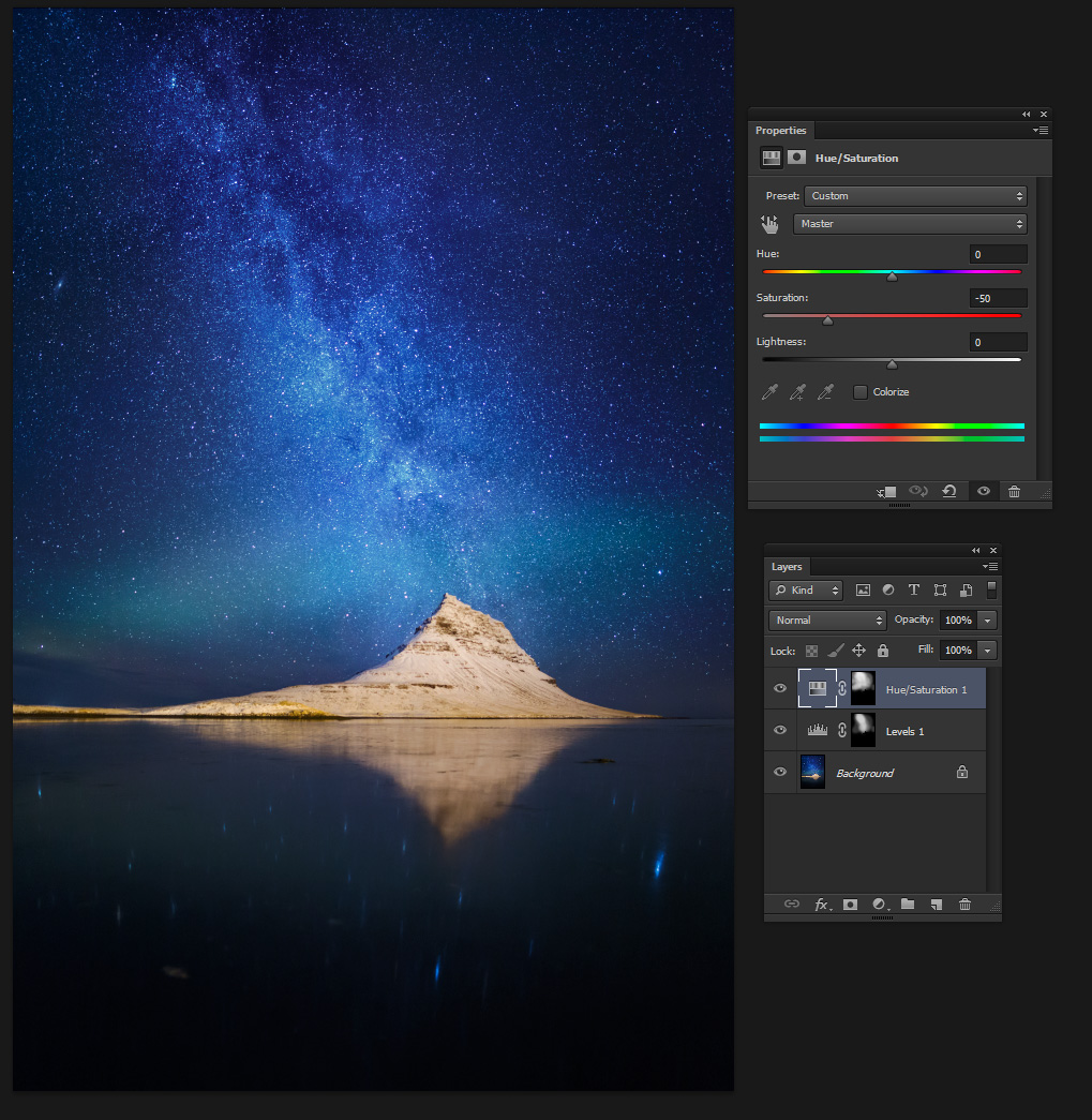 I ctrl-clicked the levels adjustment layer mask to load it as a selection, and created a new hue/saturation adjustment layer with similar mask. By reducing the saturation where the image seemed over-saturated I could restore a natural look.
