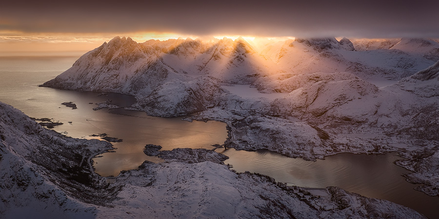 A 2-shot panorama taken from a Cessna above the mountains of Lofoten, Arctic Norway. Due to the aircraft's movement it was a bit of a difficult stitch, but still very possible and worthwhile.