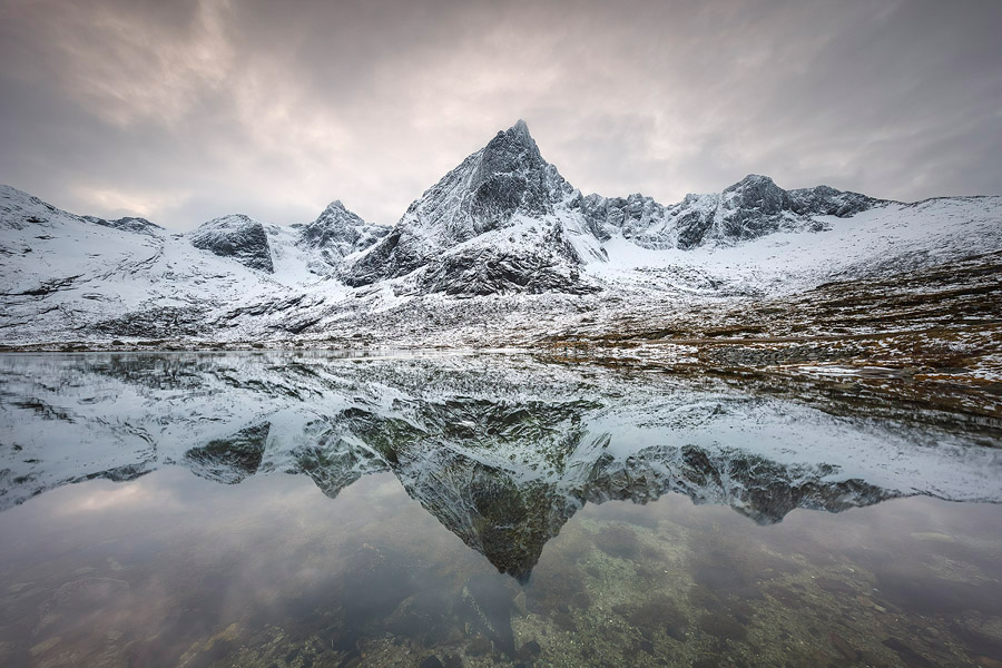 Mount Stortinden reflecting in the calm Flakstad Fjord, Lofoten. I was standing about 1 km from this 850m tall mountain. Being so close, I couldn't have included both the mountain and the reflection with a 16mm. It was easily done, however, with the 11-24mm.<br>Canon EOS 5D Mark IV, Canon 11-24mm F4L, Nisi Filters 180mm ND+GND, 11mm, F11, 0.5 sec, ISO100