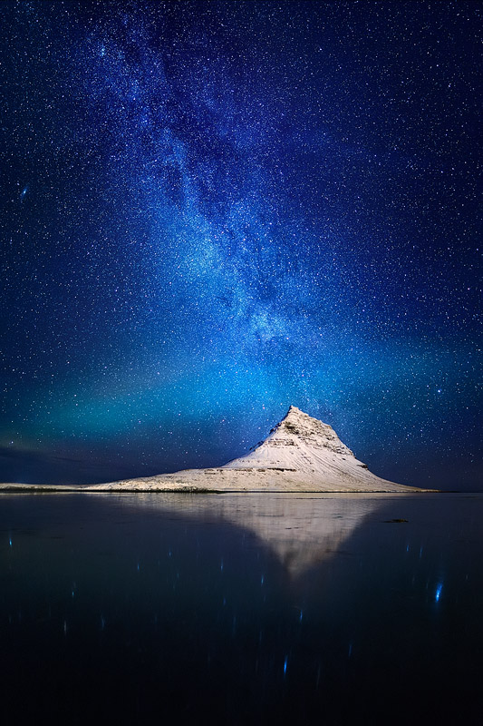 'Lost in Space', Kirkjufell, Iceland, February 2013. This image of an ultra-photographed mountain under the Milky Way and a hint of Aurora, seems to be much more special than most.