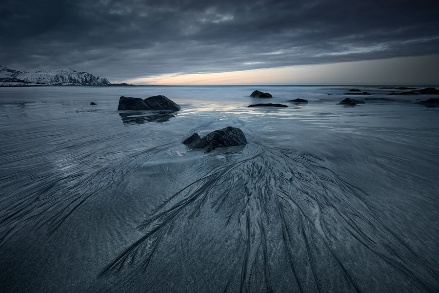 Black and white sands mix and create curious patterns in Skagsanden beach, Lofoten, Norway