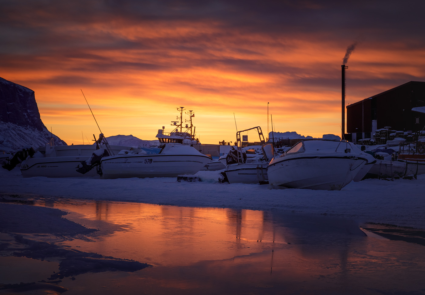 Uummannaq harbor by sunrise