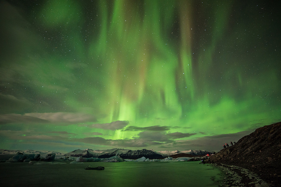 The first 2014 'Land of Ice' group shooting an amazing Aurora show over the Glacier Lagoon. Image courtesy of Lorenzo Riva