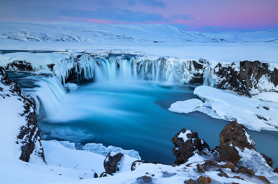 A beautiful pink sunrise over Goðafoss