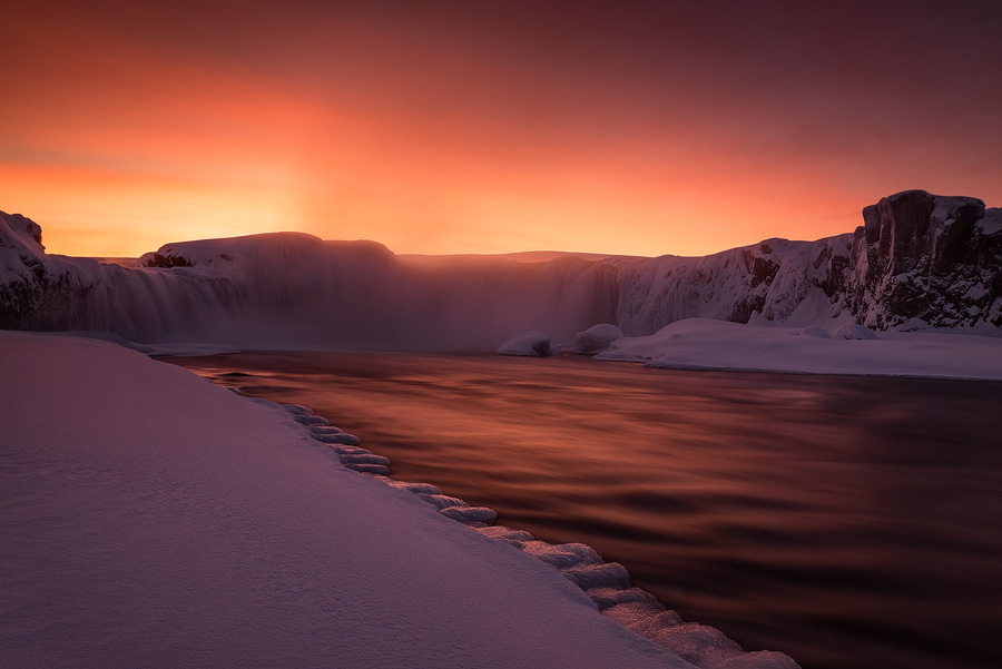 A fiery sunset over Godafoss