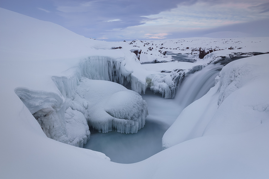 Astounding winter atmosphere in Hrafnabjargafoss