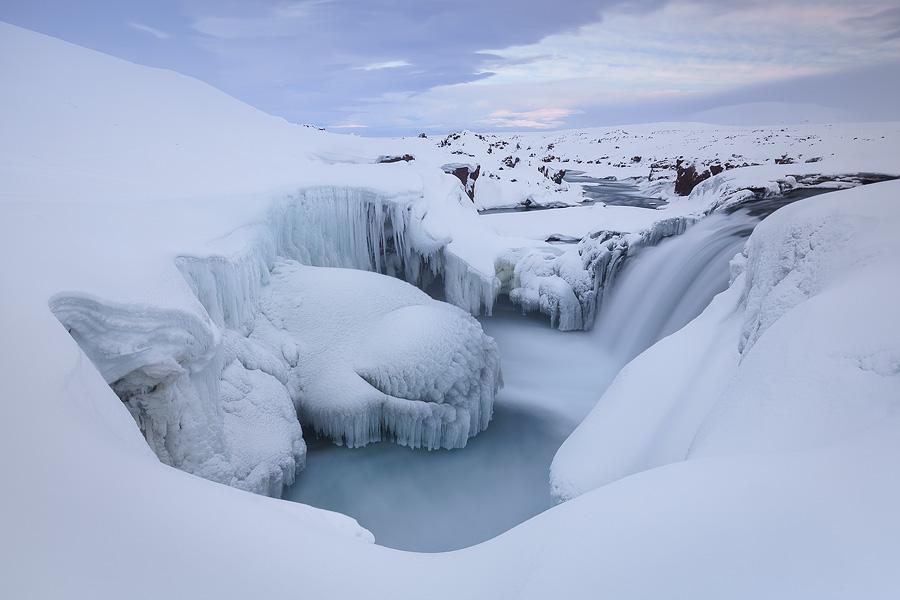 Astounding winter atmosphere in Hrafnabjargafoss