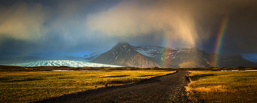 An amazing natural array of rainbows, ghost-rain, mountains and a glacier