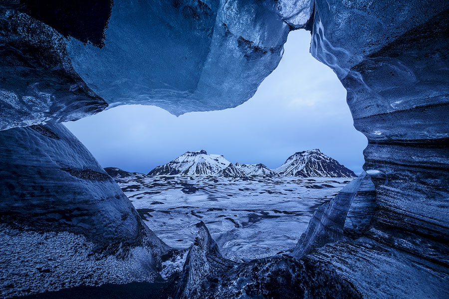 Mountains near the edge of Mýrdalsjökull, as seen from an elevated ice cave in the glacier