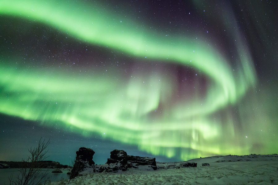 Amazing Aurora lightshow over lake Mývatn