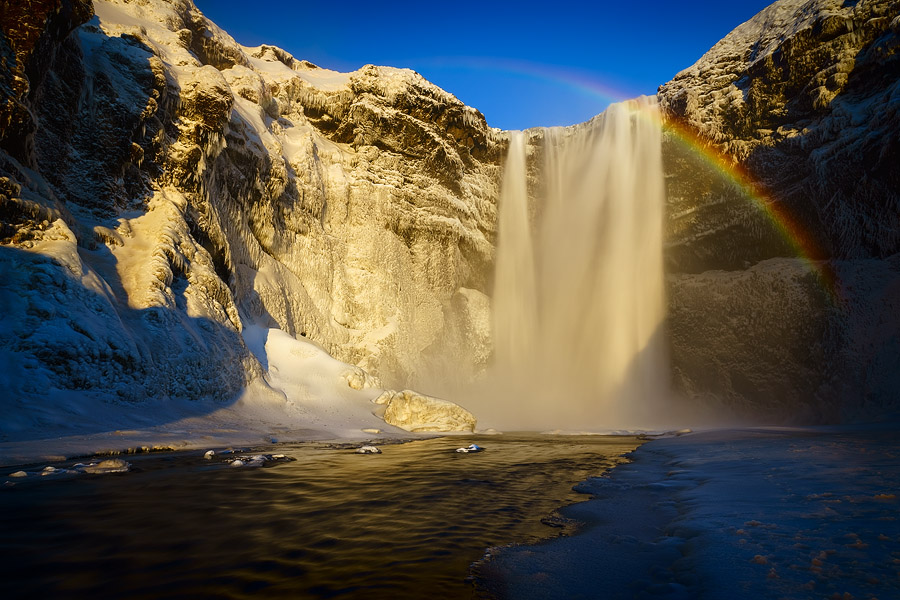 Skogafoss, dressed in white, topped with a beautiful rainbow. What more could you ask for?